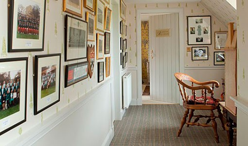 Light and airy hallway with photographs