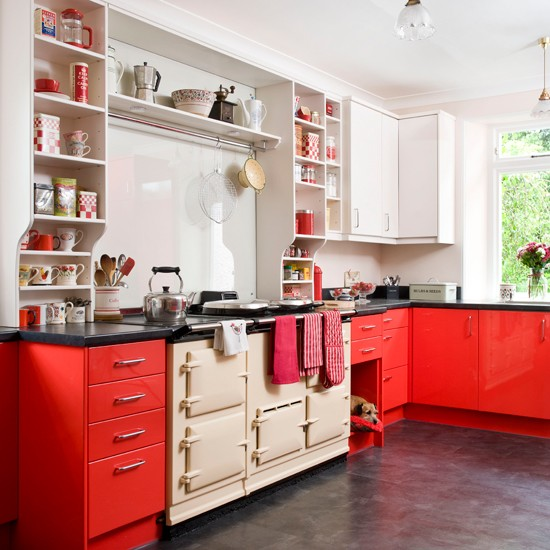 Kitchen with red units and cream aga kitchen decorating for Coloured kitchen units uk