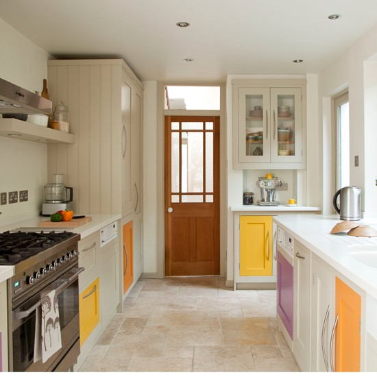 Cream kitchen with coloured doors and flagstone floor | Kitchen decorating| Ideal Home | Housetohome.co.uk