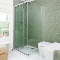 Green mosaic-tiled shower