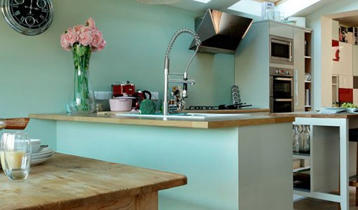 Pale green and oak kitchen
