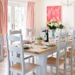 White dining room with pink and orange accents