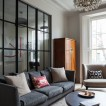 Grey living room with glass panelled wall