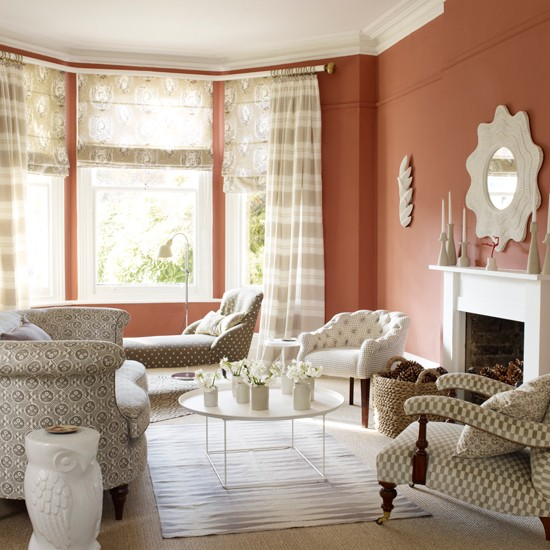 terracotta living room with patterned fabric living room