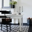 Monochrome dining room with bold flooring