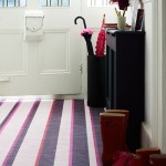 Neutral hallway with purple striped carpet