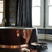 Modern bathroom with copper bath