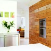 White kitchen with wood panelled wall