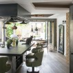 Green and dark wood kitchen-diner