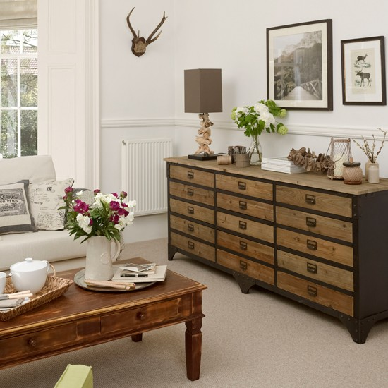 neutral living room with chest of drawers living room decorating