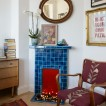 Living room with blue tiled fireplace
