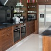 Walnut and stainless-steel kitchen