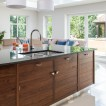 White kitchen with walnut island unit