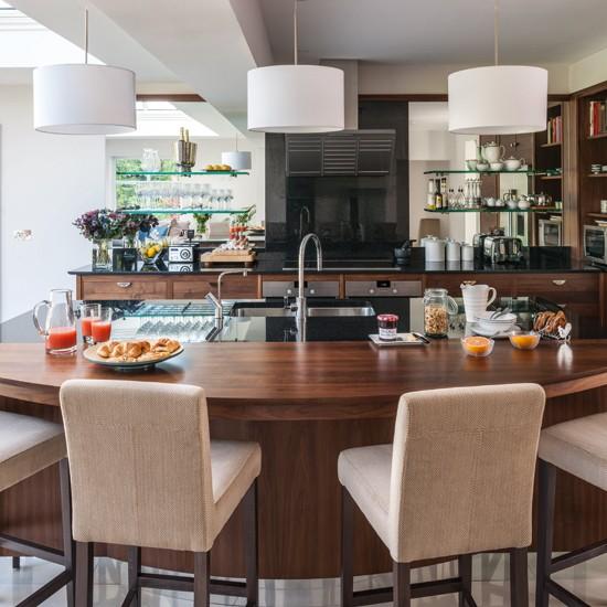 Walnut kitchen with curved breakfast bar kitchen for Kitchen breakfast bars