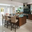 Glass and walnut kitchen with breakfast bar