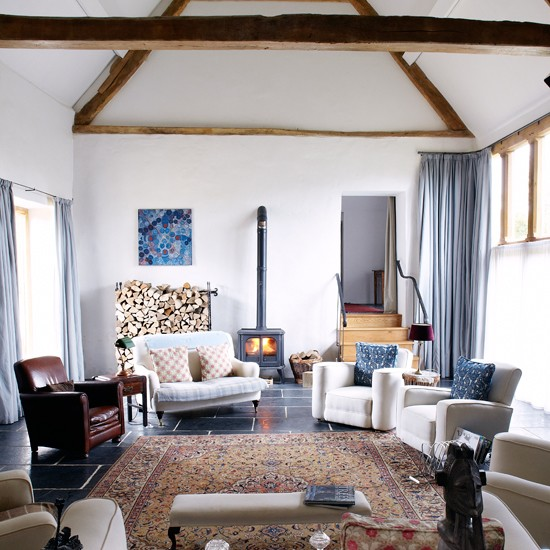Patterned Fabrics Neutral Armchairs And A Woodburning Stove Create A