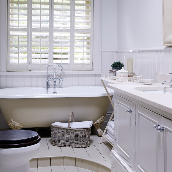 All white bathroom with roll top bath and shutters for All white bathroom designs