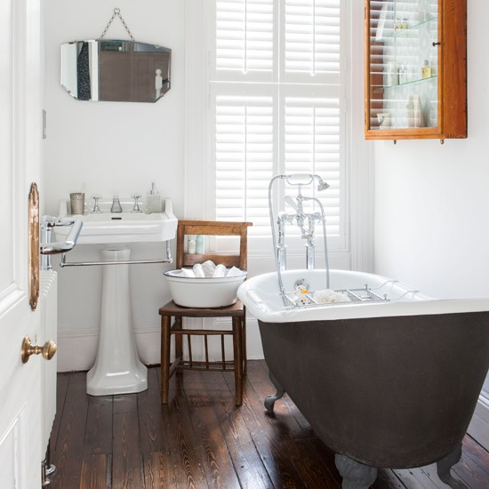 White bathroom with wooden floor bathroom decorating for Hardwood floor in bathroom