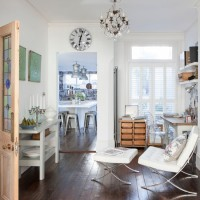 White home office with wooden floor