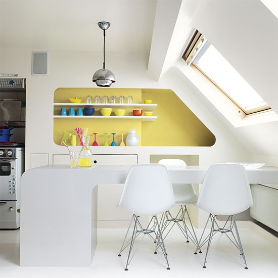 kitchen with bold yellow feature wall colouful kitchen