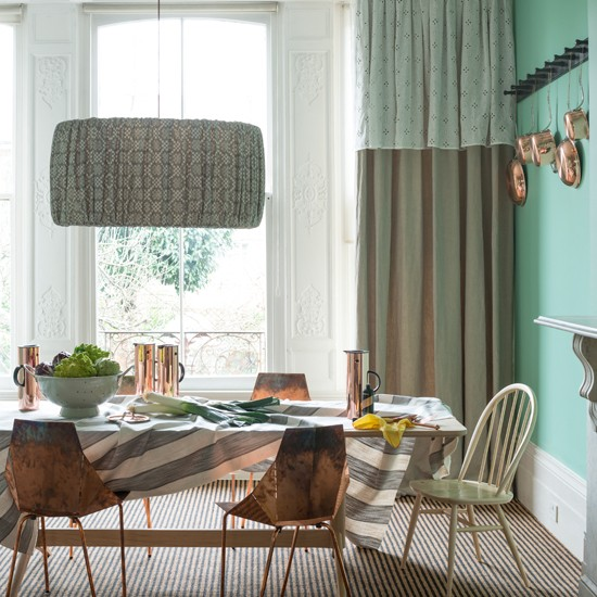 Jade green dining room with copper chairs Dining room