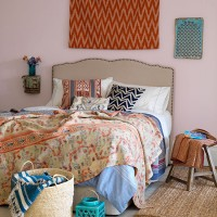Country bedroom with vintage quilt