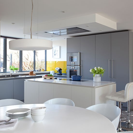 Grey kitchen with white island for Grey yellow kitchen ideas