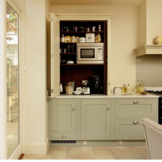 Traditional Stule Cream And Green Kitchen With Concealed