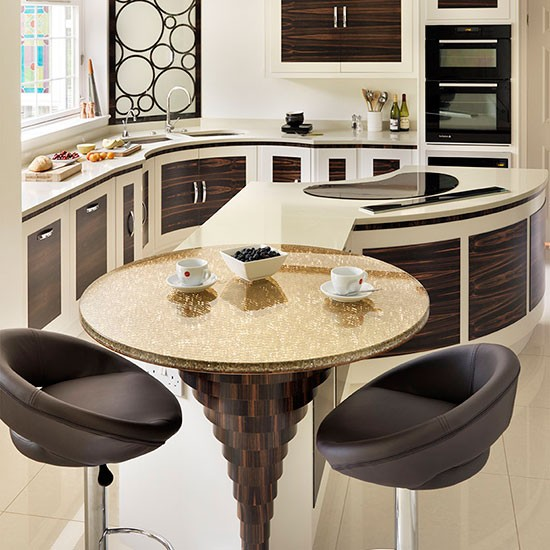 Take a tour around a modern kitchen with curved dark wood for Curved kitchen units uk