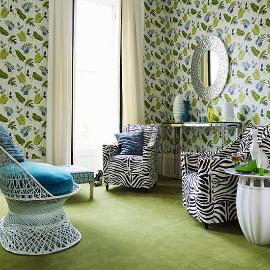 Living room with leaf print wallpaper green carpet and zebra print