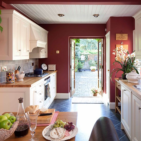 Rich Red Cabinetry Makes This An Inviting Place To Cook