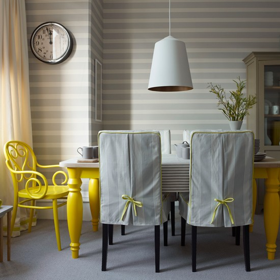 grey striped dining room with yellow chair grey and