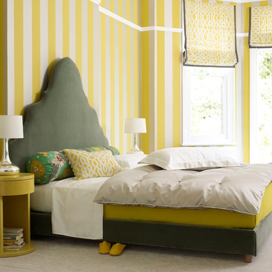 bedroom with striped yellow wallpaper grey and yellow