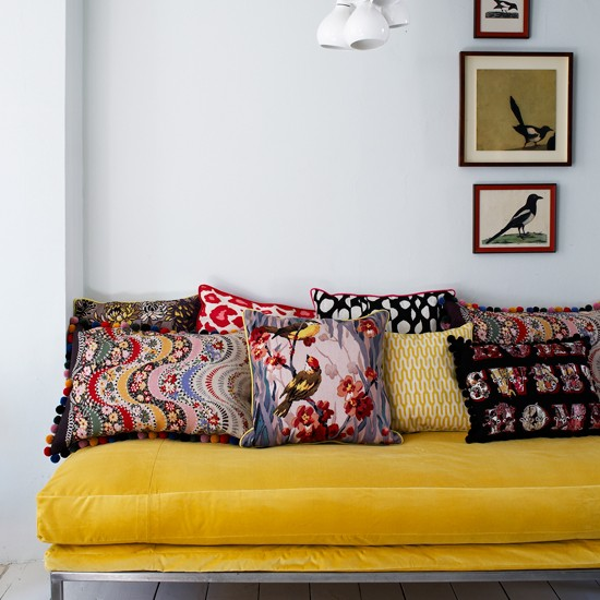 Living Room With Yellow Sofa And Grey Walls