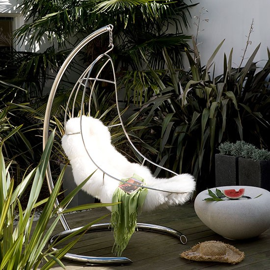 Modern garden with retro swing chair | Modern garden design ideas | Garden design | PHOTO GALLERY | Housetohome.co.uk