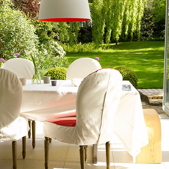 Modern garden with orange and white dining area | Modern garden design ideas | Garden design | PHOTO GALLERY | Housetohome.co.uk