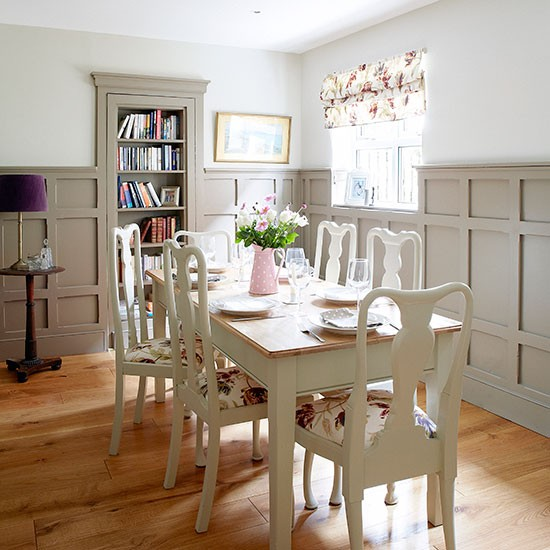 Pale grey dining room with painted wall panels