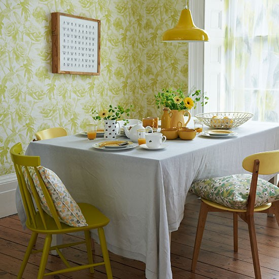 Yellow retro dining room with floral wallpaper dining for Dining room decorating ideas yellow