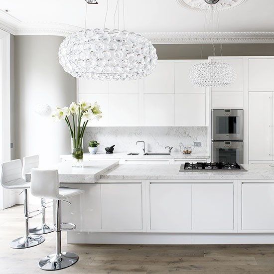 white kitchen with glamorous lighting white kitchen