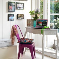 White country-style home office with pink chair
