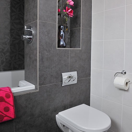 Bathroom with grey tiles and pink accents | Bathroom decorating ...