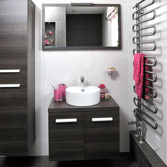 bathroom with walnut vanity unit