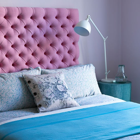 pink headboard and blue bedlinen colourful bedroom ideas bedroom