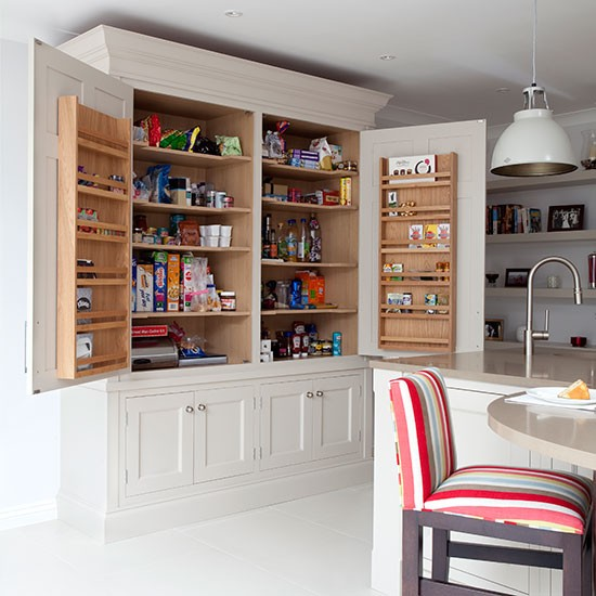 Pale grey kitchen with Shaker-style larder cupboard