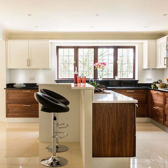 modern cream kitchen with walnut units kitchen