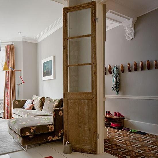 Pale grey hallway with wooden door | Hallway decorating ...