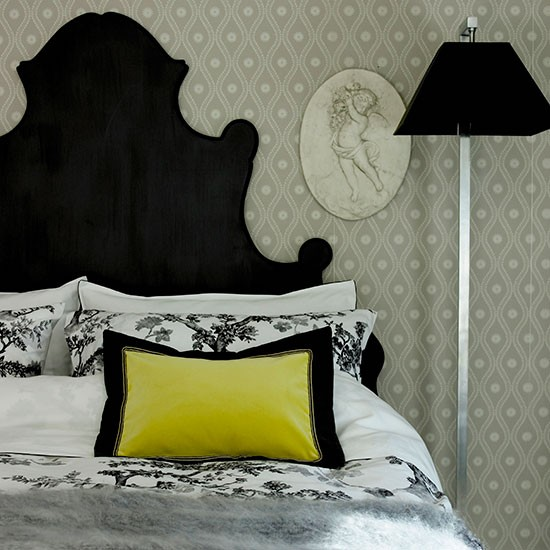 Black and white bed with yellow cushion
