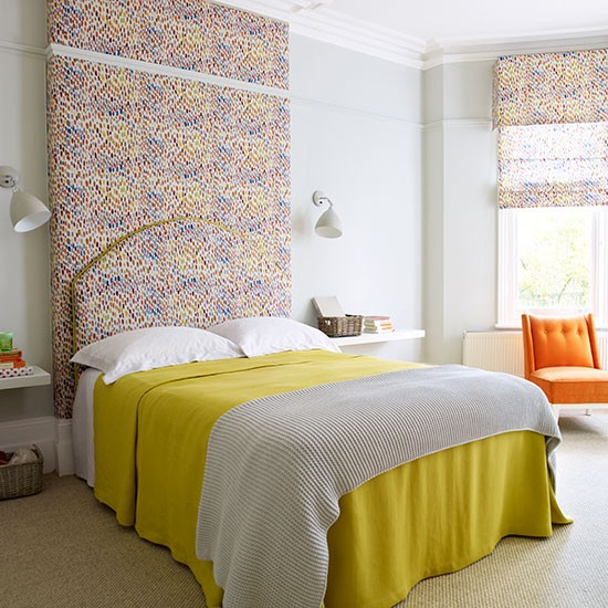 Modern Bedroom With Colourful Headboard And Feature Wall