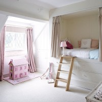 Girl's bedroom in white and pink with boxed-in bed