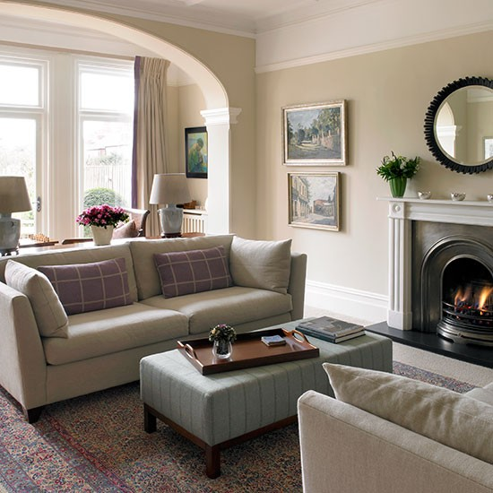 Traditional cream living room with arch living room for Designs of arches in living room